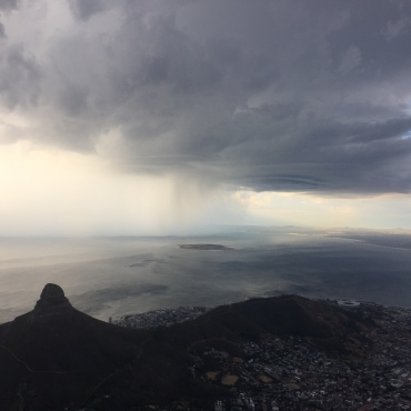 Lions head and approaching storm on 365 Ubuntu Climbs 58 Summit